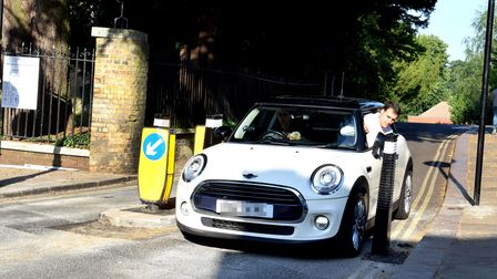 A Mini going through the new width restriction on Church Row