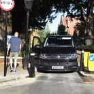 A driver gets out to look at the new width restriction on Church Row, Hampstead