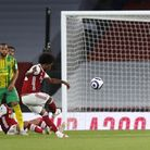 Arsenal's Willian scores a free kick against Norwich in May