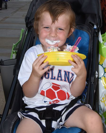 Hayden McClean aged 4 enjoys his ice cream whilst out in Romford town centre with his grandmother