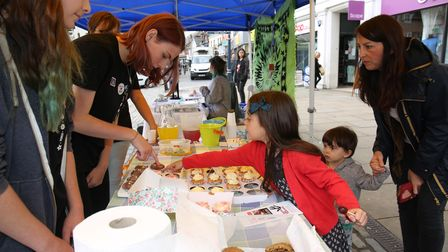 School students selling cakes on a market stall with the National Citizenship Service.