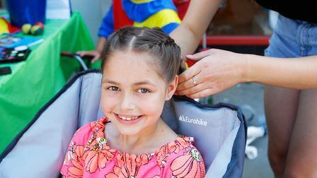 Ava-Lily, 8, has her hair plaited atAlta Hairdressers charity event in Hitchin on Sunday (July 18)