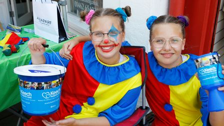 Phoebe and Olivia, 11, at Alta Hairdressers charity event, in aid of Keech Hospice Care