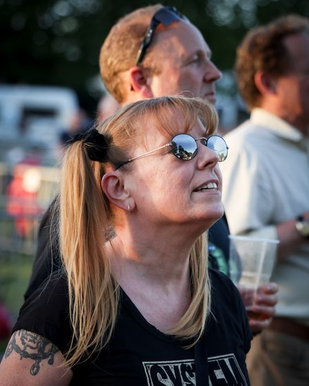 A woman with her hair in bunches. She watches Dennis Stratton at Saffron Walden's Big Day Out
