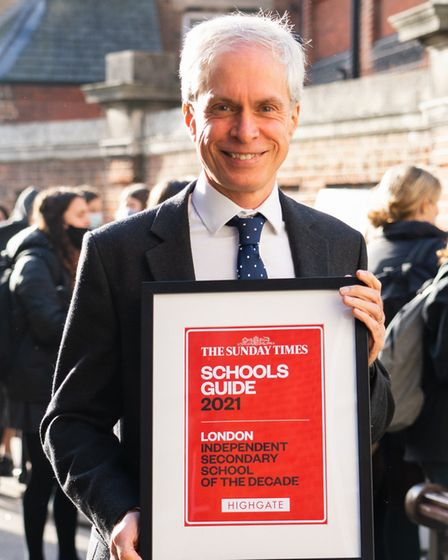 Adam Pettitt with the Sunday Times/ Parent Power 'Independent School of the Decade' award. Picture: