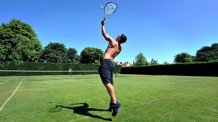 Playing tennis at Heigham Park in the July heatwave. Photo: Bill Smith