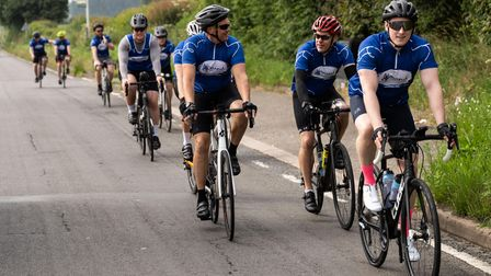 Charity cyclists fromBoom Construction and TRAC Construction Ltd in Chiswell Green, St Albans.