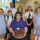 Worstead C of E Primary School's dinner lady Cynthia Clare MBE, pictured with the school councillors