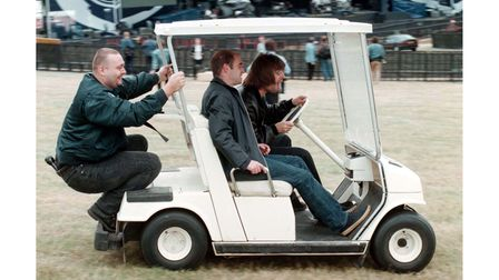 Pictured August 9, 1996,Liam Gallagher from Oasis driving a golf cart ahead of their performances at Knebworth
