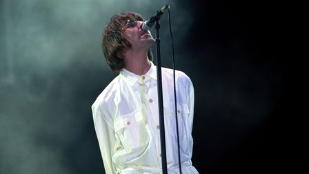 Pictured on August10, 1996,Liam Gallagher performing with Oasis at Knebworth Park in Hertfordshire.