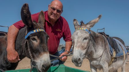 Kevin Mager with two of his donkeys on Weston-super-Mare beach.