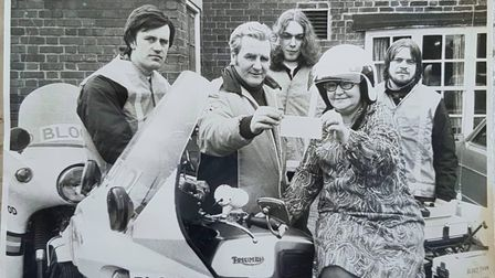 A black and white photograph of Freewheelers with motorbikes
