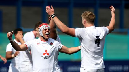England's Josh Gray (left) and Arthur Clark (right) celebrate at full time afterthey won the 2021 U20 Six Nations