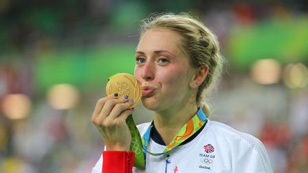Great Britain's Laura Trott kisses her gold medal after winning the Women's Omnium Points Race 6/6 a