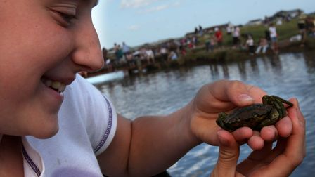 Competitor Tonicha Kent, 11, from Lowestoft who takes a closer look at her catch during the annual B