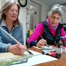 Liz and Barbara painting together