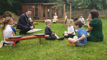Harpenden Mayor Cllr Paul Cousin witnesses the burial of the time capsule at Roundwood Primary.