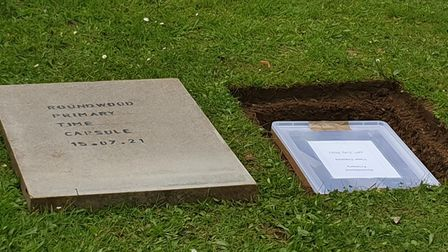 The time capsule is buried at Roundwood Primary School in Harpenden.