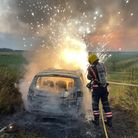 Dramatic photo shows car ablaze in North Brink, Wisbech, after arsonists strike.