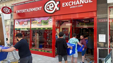 Cex staff holding packages.