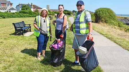 Rachael Williams with Tina and Ernest Andrews as the'Sea for the Soul' group collected rubbish.