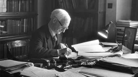 British politician and economist Lord William Henry Beveridge (1879 - 1963), working in his study at