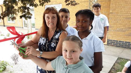 Headteacher Penny Martin opens memorial garden with Mossford Primary School students
