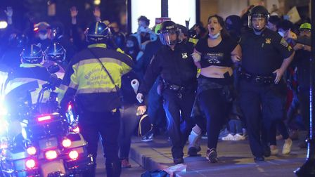 Boston Police Officers arrest a protester in Downtown Crossing in Boston on May 31, 2020. Violent pr