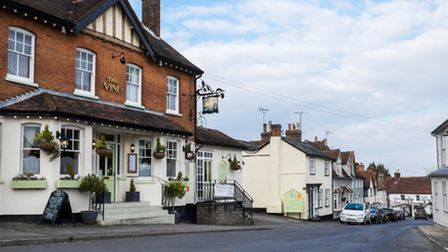 A street in Bardfield with old buildings and a pub.