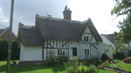 A thatched cottage with beams on the outside in Hempstead, Essex