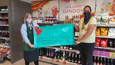 Lucy from Action For Children, Sidmouth, collects her cheque