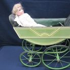 A china doll and pram on display at the St Neots Museum in New Street.