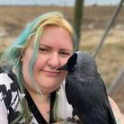 Kat Tate with a feathered friend at Wild Touch animal rescue at Ridlington.