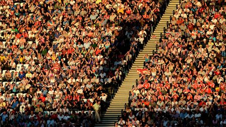 The crowd cheer from the stands on day twelve of the London Olympic Games at the Olympic Stadium in
