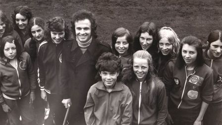 Dave Naylor with a group of young athletes