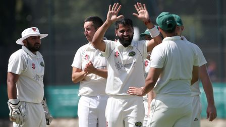 Shahbaz Khan of Harold Wood celebrates taking the wicket of Bilal Patel during Wanstead and Snaresbr