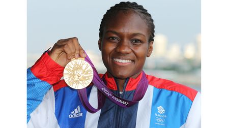 Great Britain's Nicola Adams celebrates with her Olympic gold medal