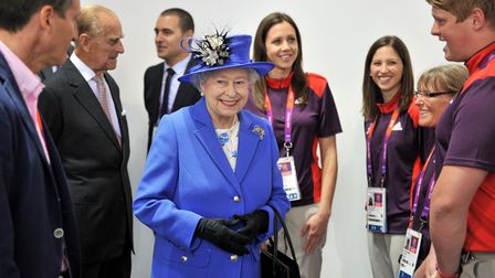 Queen Elizabeth II meets volunteers at the Aquatics Centre in London on day one of the London 2012 O