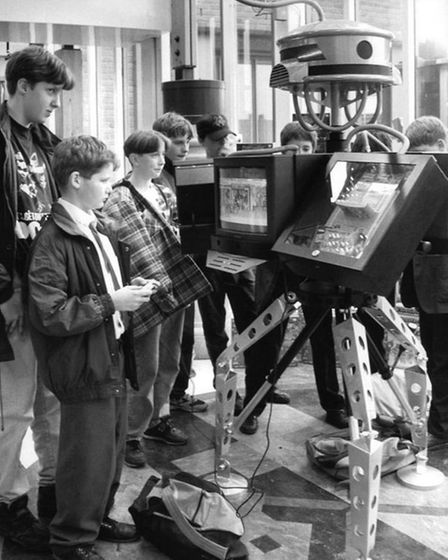 Youngsters try out computer games on the android at Virgin Megastore in 1993.