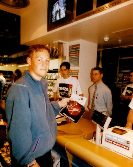 One of the first shoppers at the grand opening of the Virgin Megastore, Norwich in 1993.