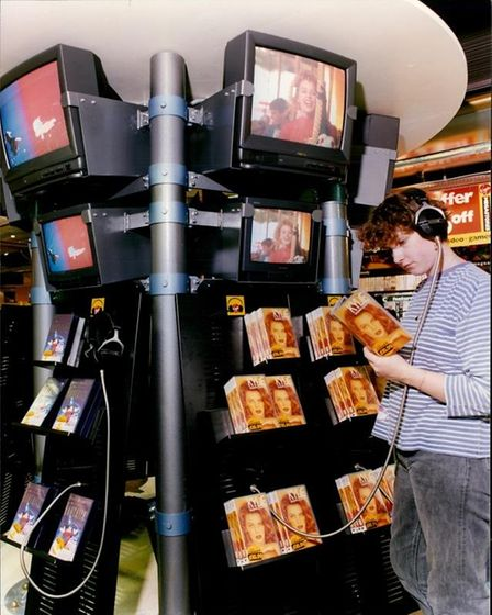 A customer listens to music at one of the sampling stations atVirgin Megastore in Norwich, Norfolk in 1993.