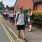 Sports coach James Roberts i welcomed into St Williams Primary in Thorpe St Andrew after his 14 mile walk.