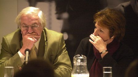 Delia Smith hides from the camera at the Norwich City Football Club Annual General Meeting , seated