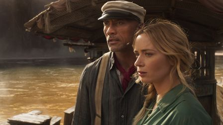 Dwayne Johnson is Frank and Emily Blunt is Lily in Disney's JUNGLE CRUISE.
