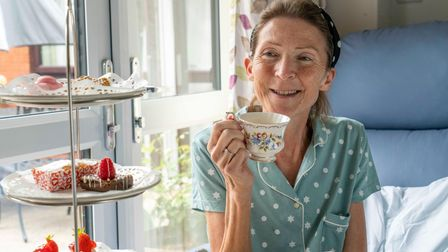 Isabel Hospice patient Gill Eliot enjoys afternoon tea during her stay at the In-Patient Unit