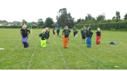 A race to the finishing line for reception children.