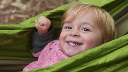 A baby taking part in the Tree Babies group at Wild Touch forest school.