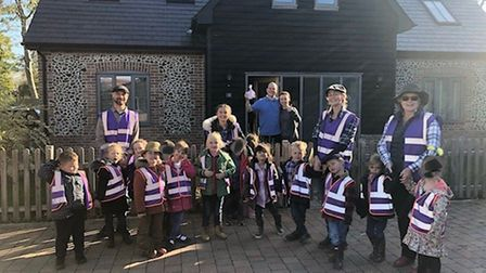 Honeypot class reception children delivering their goodies with happy residents in the background. P