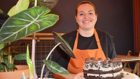 Manager of Tofurei, Lizzie Frisby, with the dinosaur nest cake which is part of the Norwich dinosaur food trail.