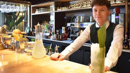 The Ivy head bartender Ajay Packard-Iveson with the dinosaur tail cocktail which is part of the Norwich dinosaur food trail